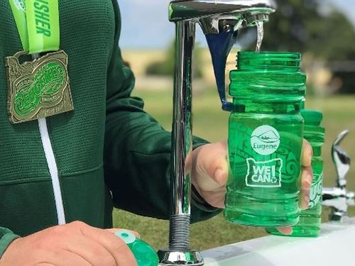 Water filling stations allow event goers to fill their own water bottles