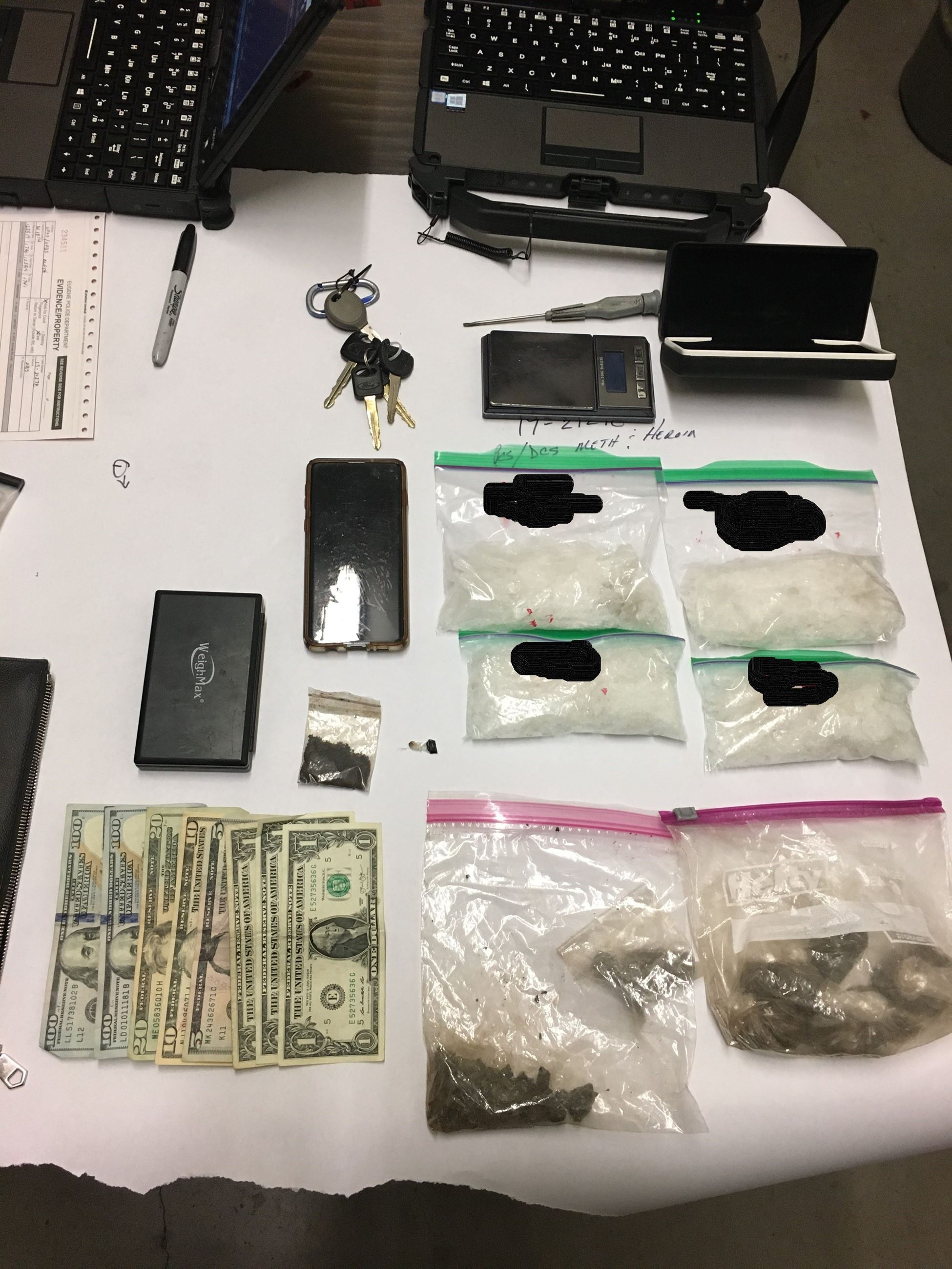 Photo of drugs and money seized during arrest by Street Crimes Unit