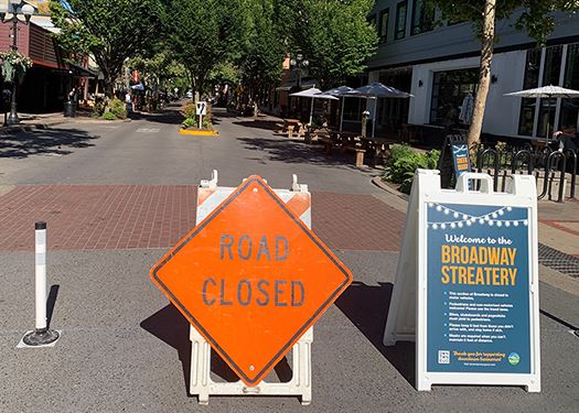 Broadway between Willamette and Olive is closed to traffic to offer restaurants expanded cafe seatin