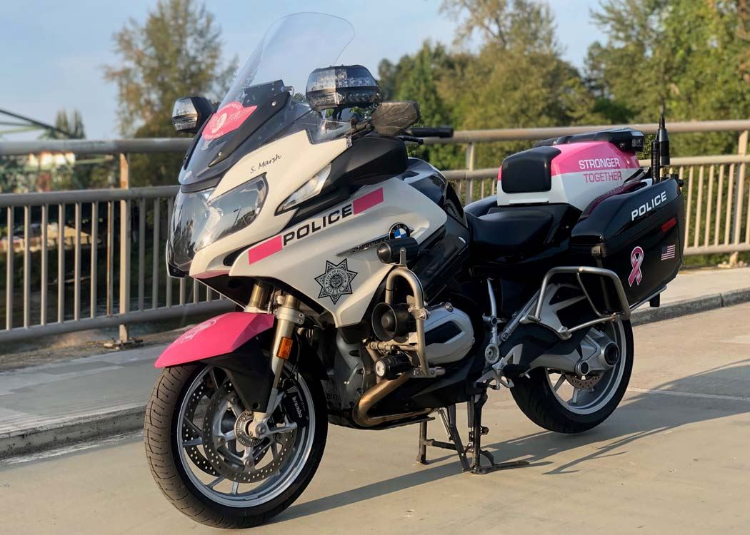 Breast Cancer Awareness Month - traffic safety motorcycle with pink graphics