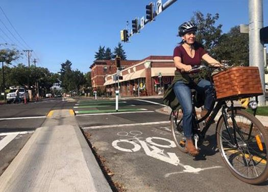 Woman riding on her bike on the new 13th Avenue bikeway