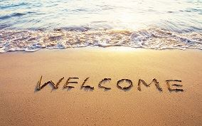Welcome written in the Sand Opens in new window
