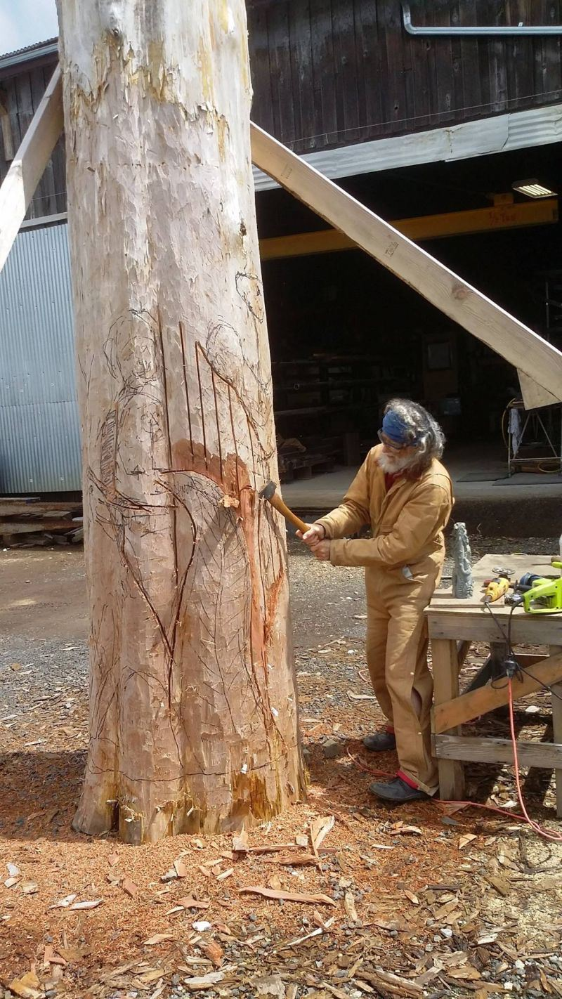 Cedar Caredio at work on totem