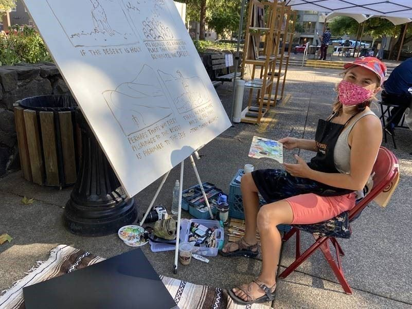 Artist sketching outdoors at the Farmer's Market