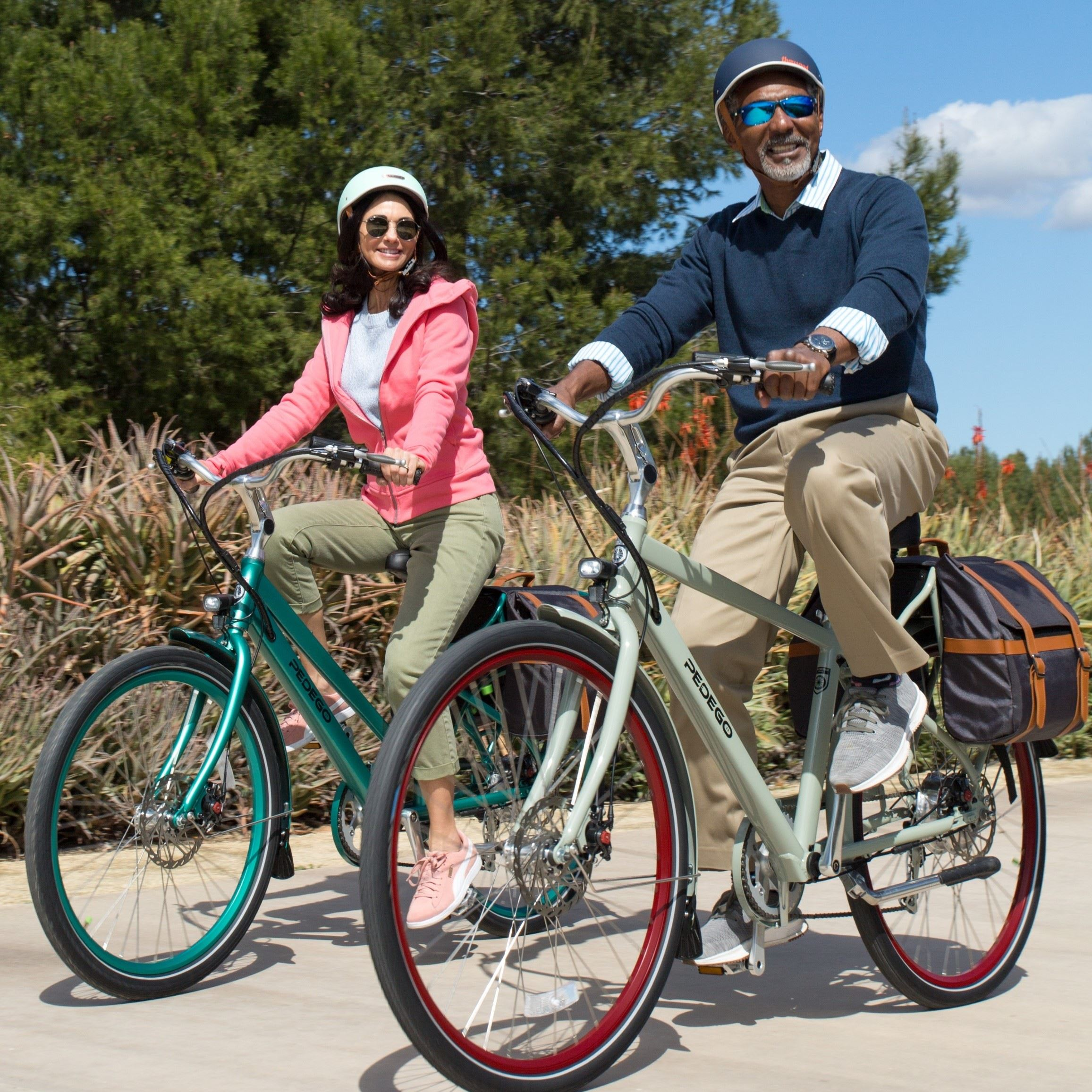 A man and a woman riding electric bicycles